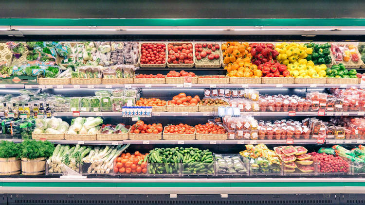 Produce wall of a supermarket, full of fruit and vegetables